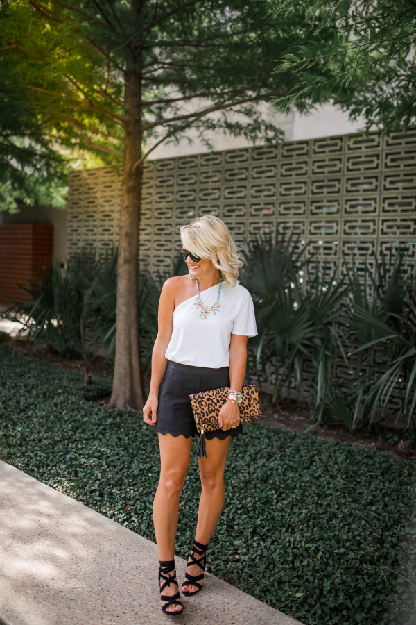 black scallop shorts with white one shoulder top