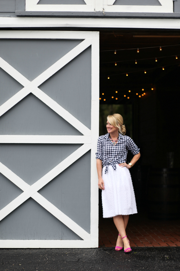 gingham shirt trend white skirt outfit by barn door
