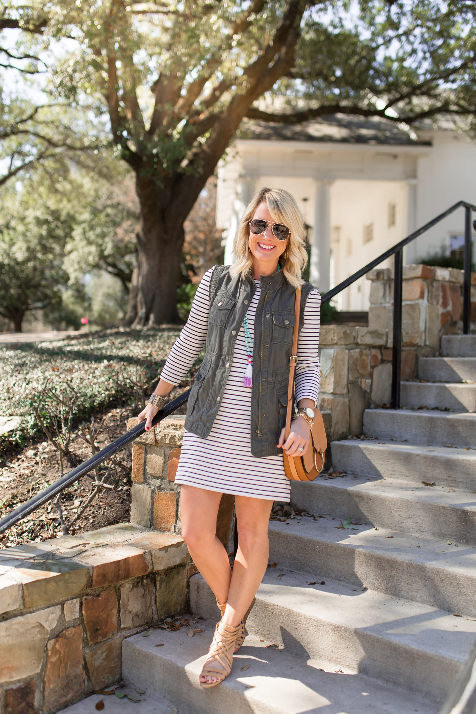 striped dress with military vest outfit at arlington hall dallas