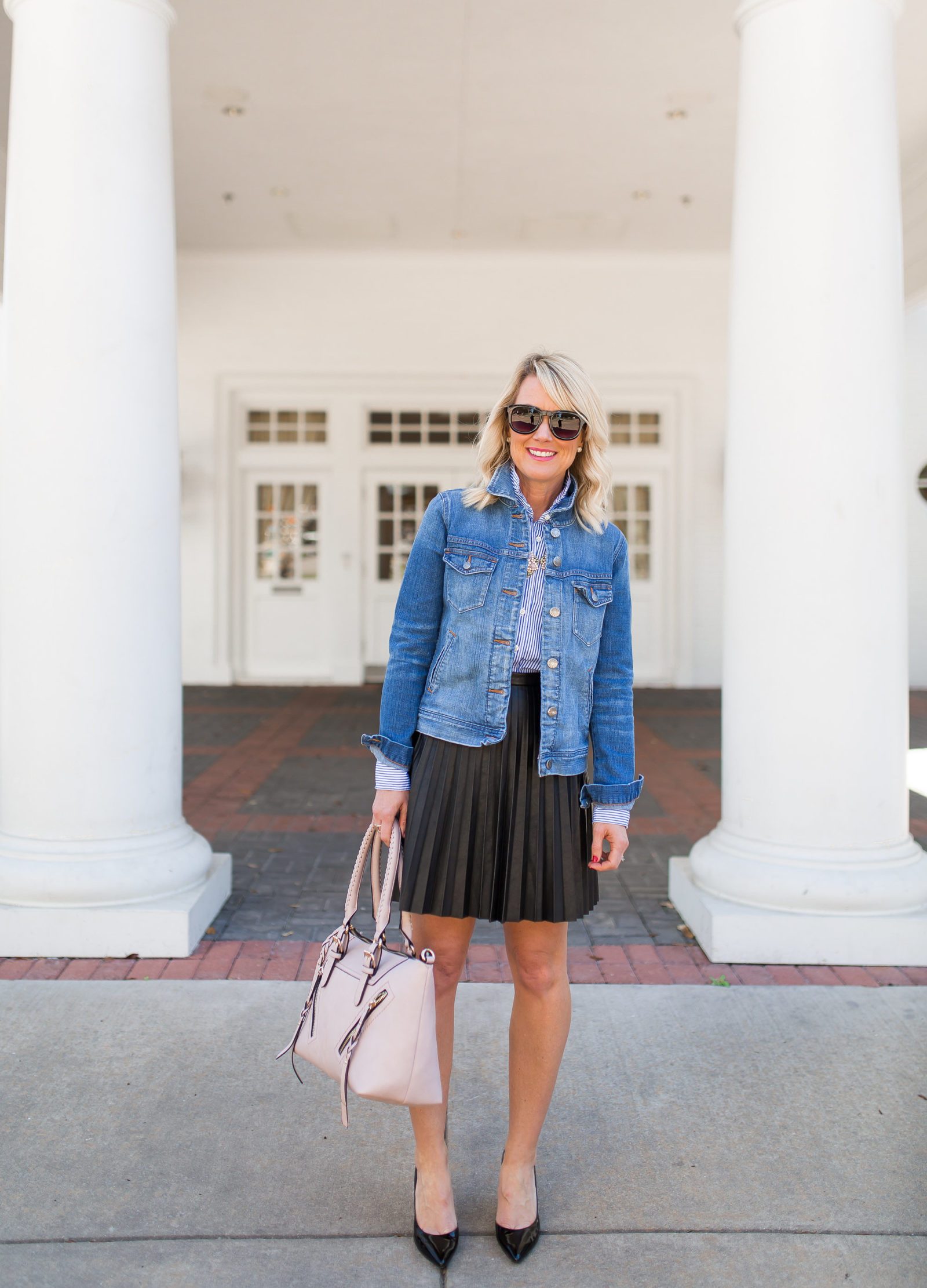 black pleated skirt outfit at arlington hall dallas