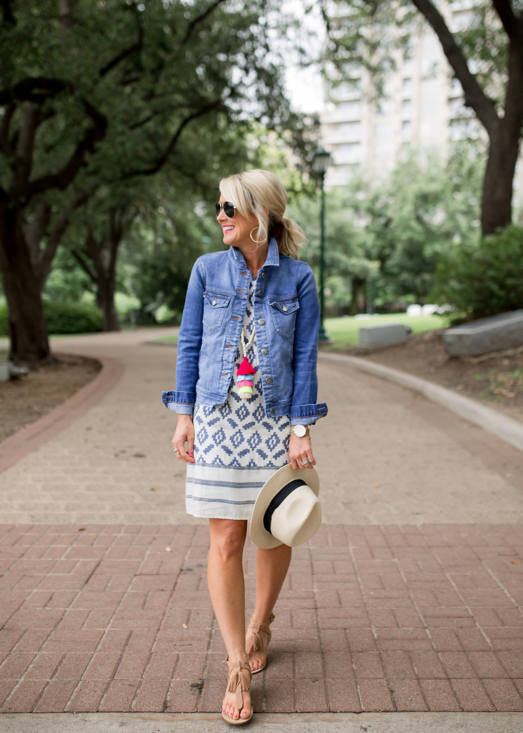 jean jacket in summer with sundress and tassel necklace