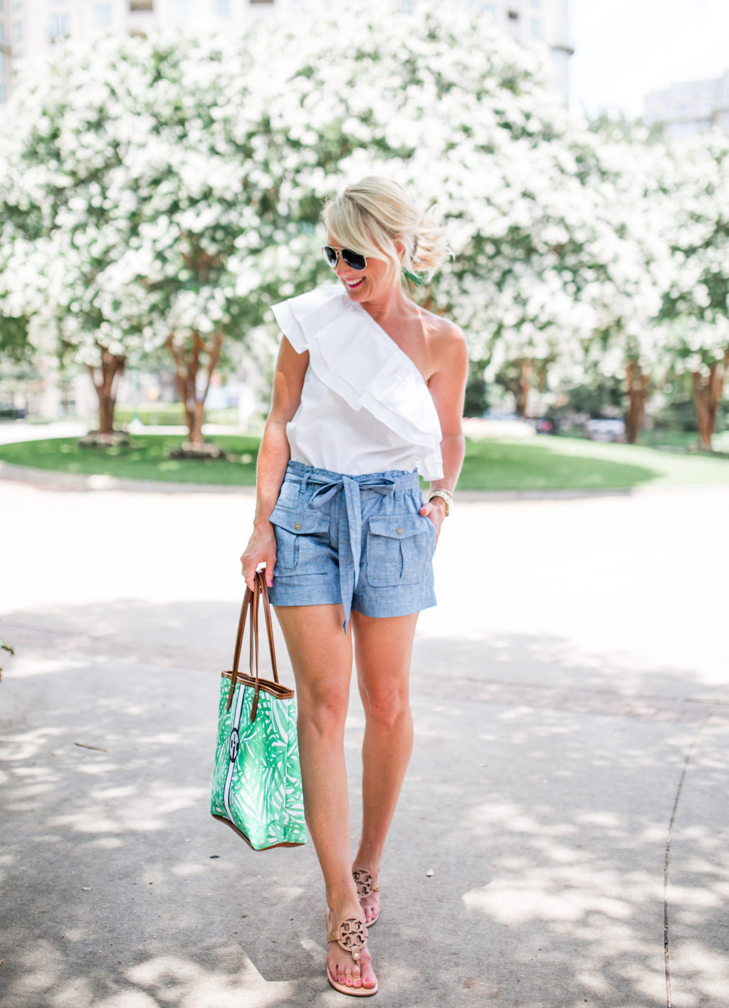 white one shoulder ruffle top with blue chambray paper bag shorts