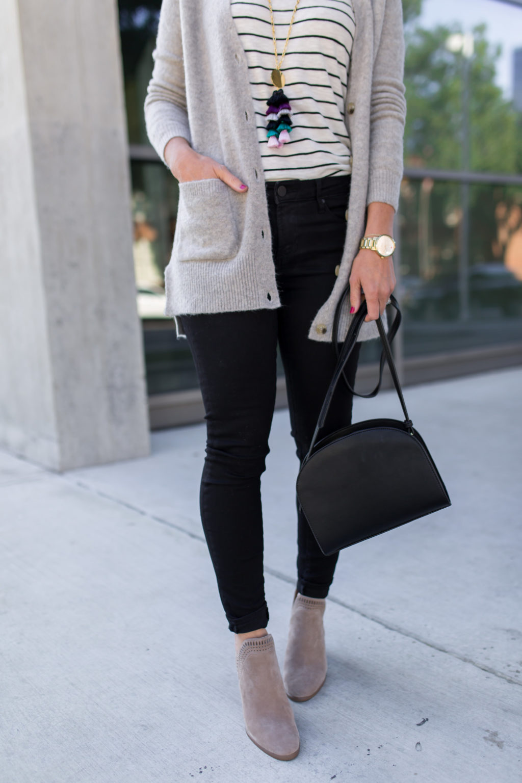 black jeans and taupe boots