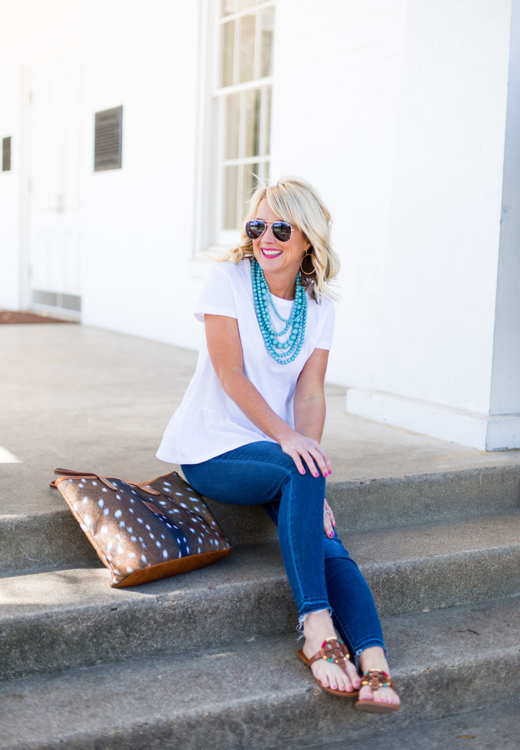 woman sitting on arlington hall steps dallas with barrington gifts tote bag rayban sunglasses tory burch miller flip flops
