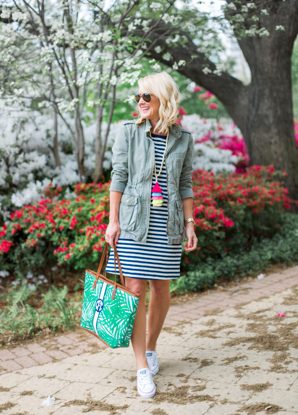 blond woman at arlington hall dallas wearing old navy striped dress barrington tote tassel necklace