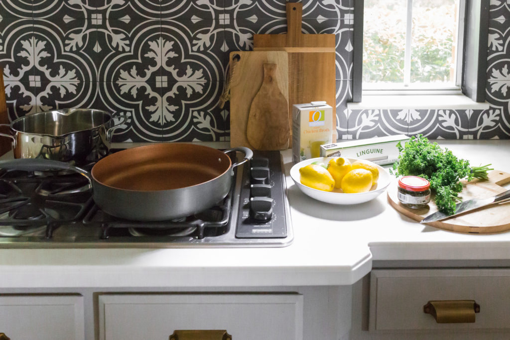 lemon chicken piccata ingredients and cookware in kitchen