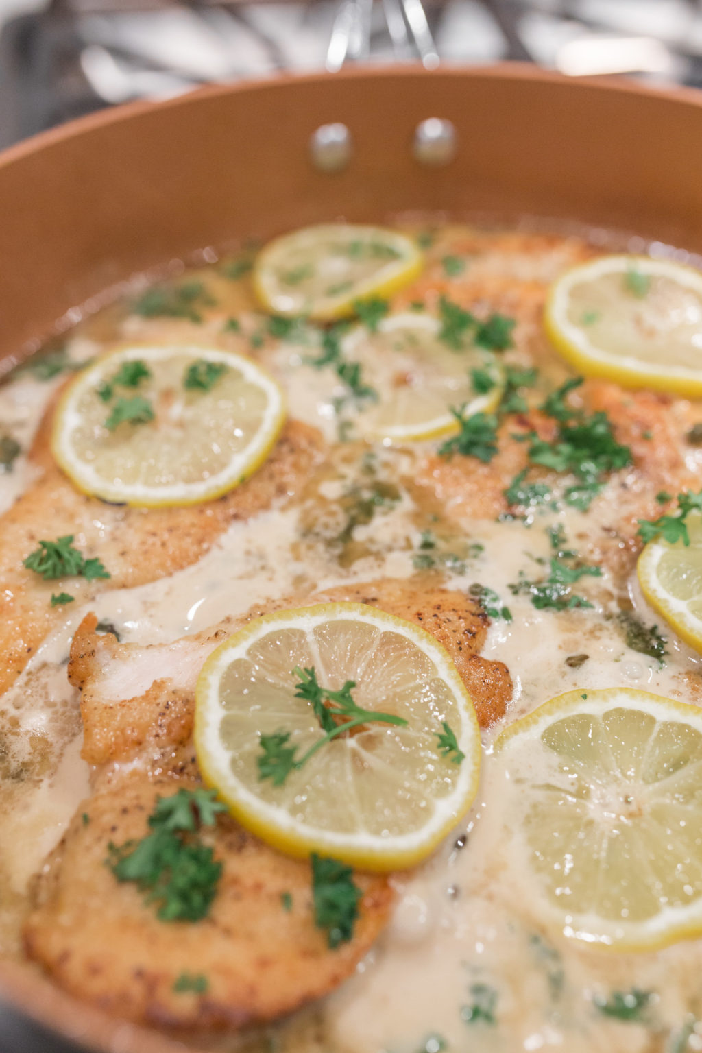 simple creamy lemon chicken piccata cooking in skillet