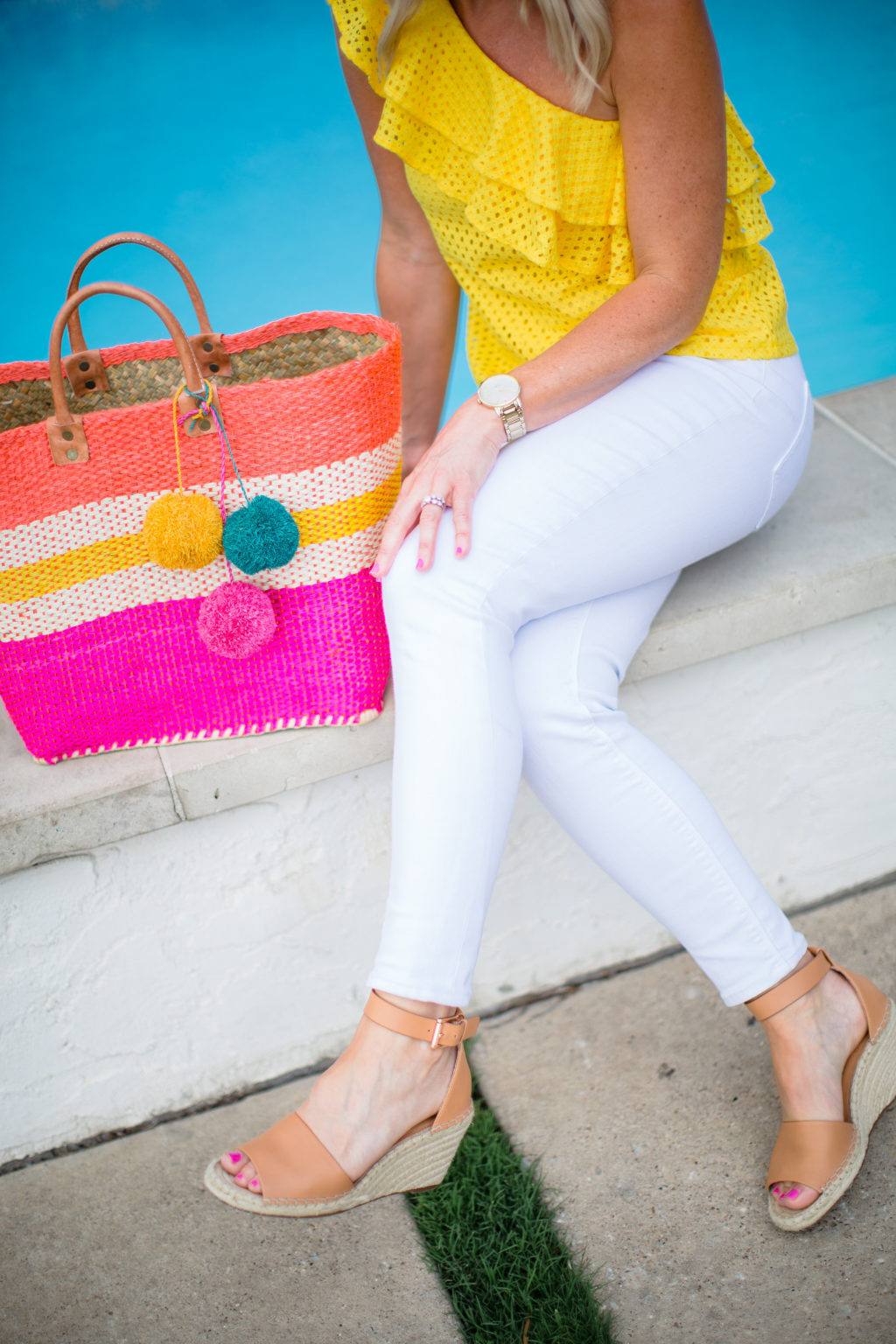 yellow pink straw bag white jeans