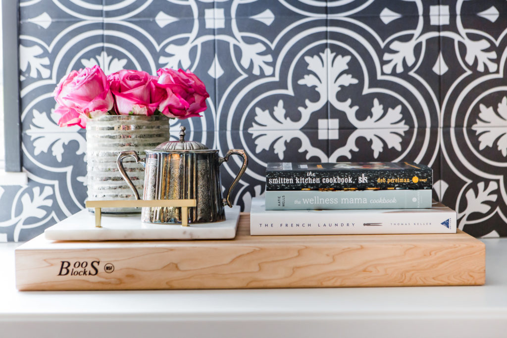 cookbooks and flowers on cutting board