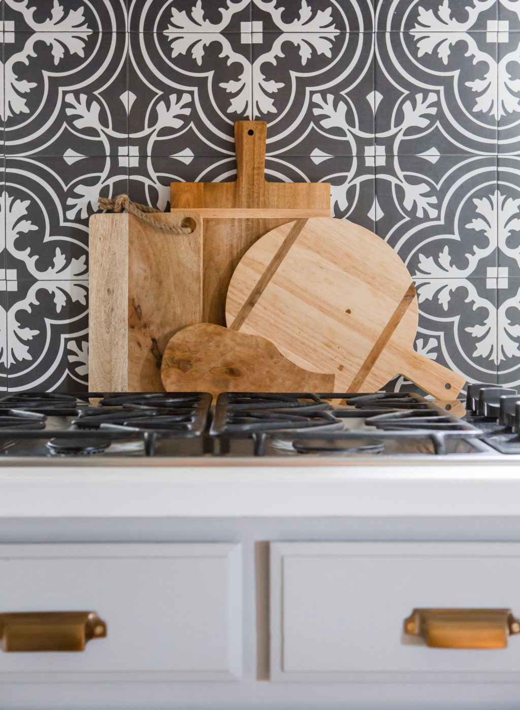 serving and cutting boards on kitchen countertop