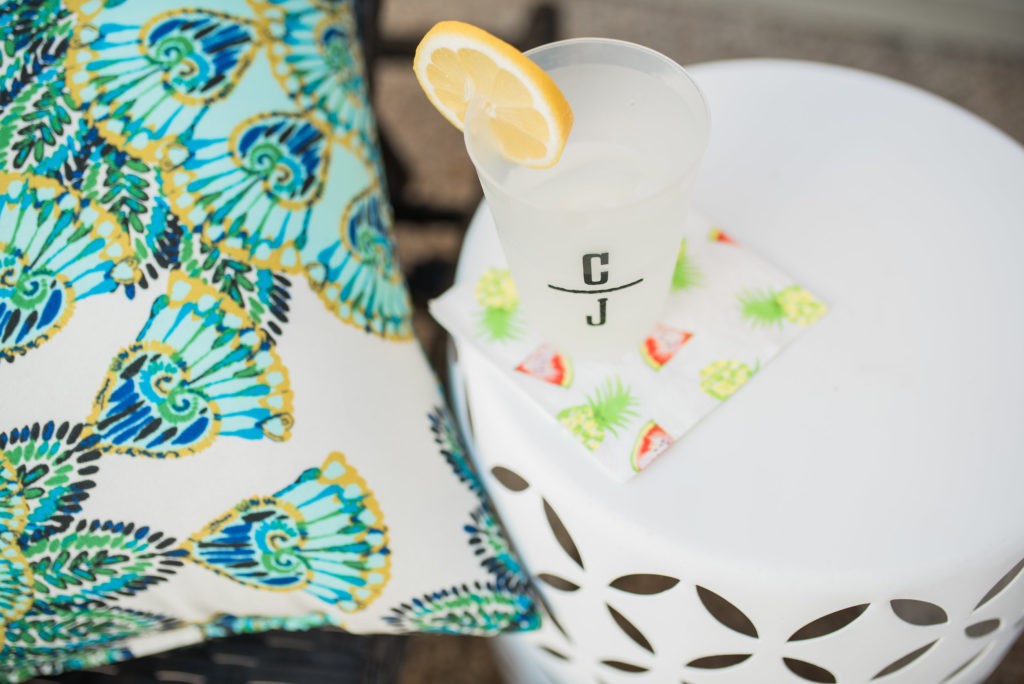 cocktail on outdoor garden stool as patio side table