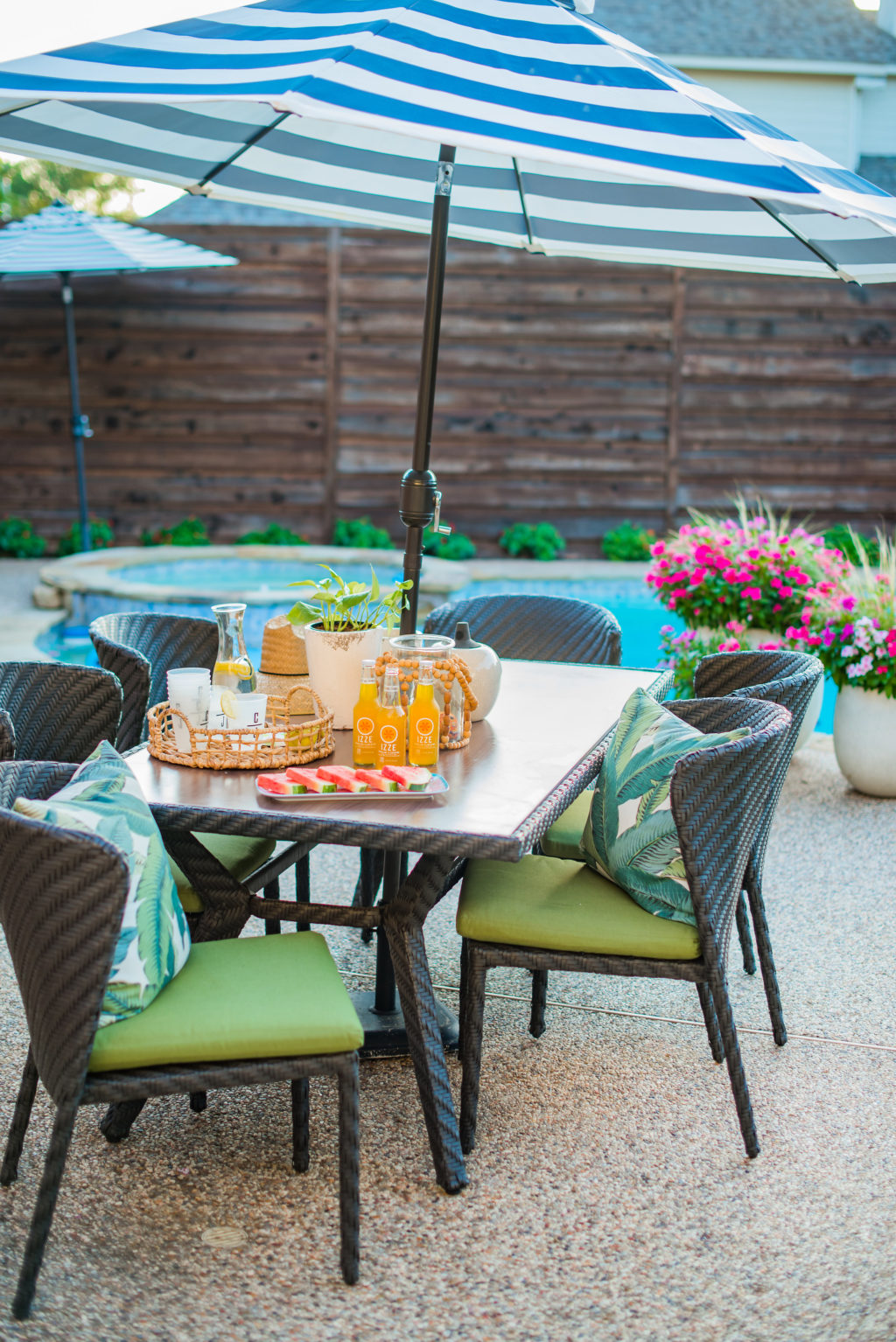 pool patio furniture behind backyard privacy fence during summer