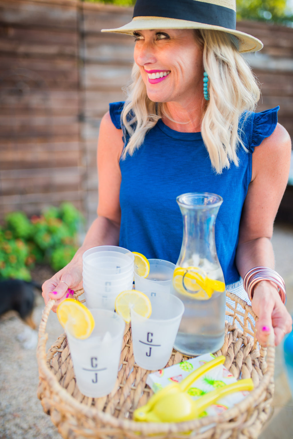 mom serving water with lemons during summer in backyard