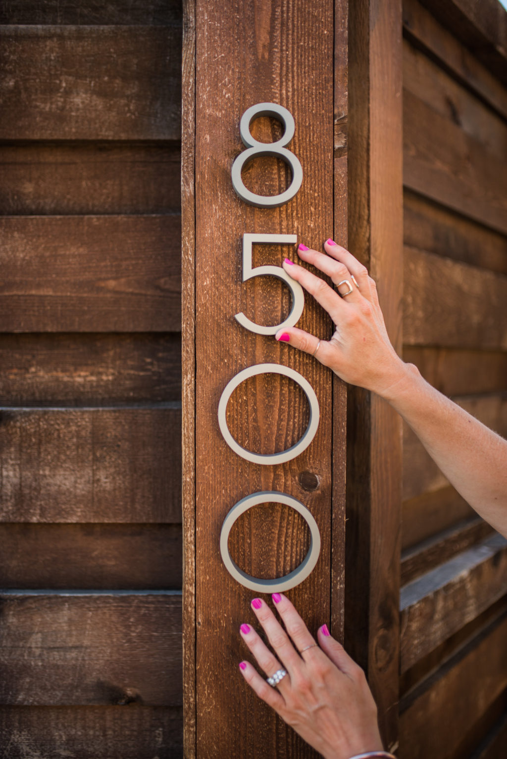 hanging address house numbers on horizontal wooden backyard privacy fence