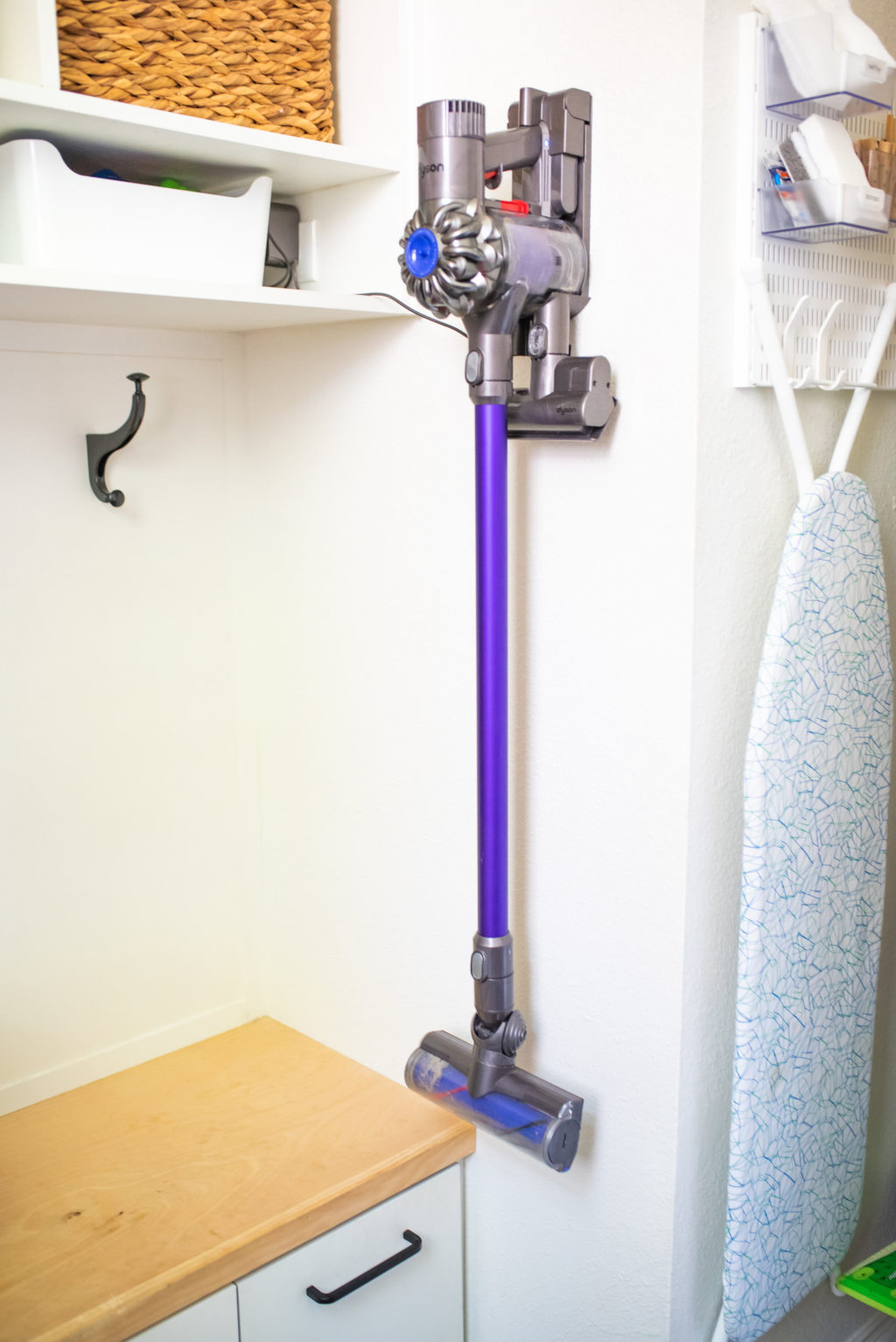 dyson stick vacuum on wall