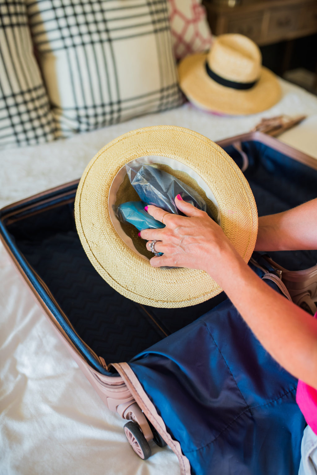 filling a hat to pack inside a suitcase
