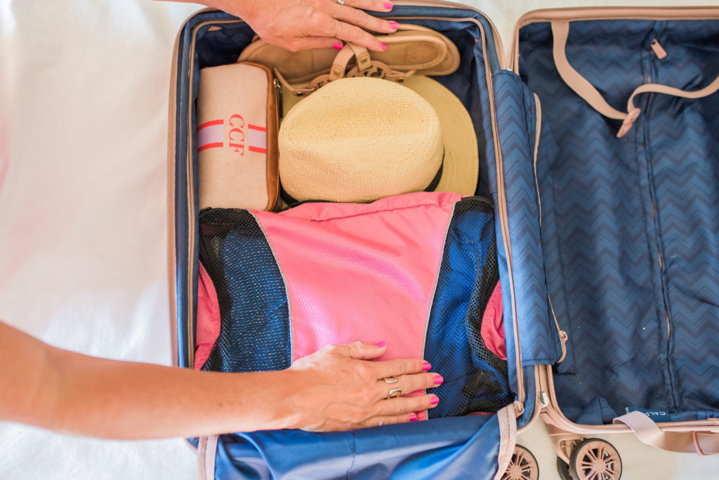 how to pack a hat with other clothing in a carry on suitcase