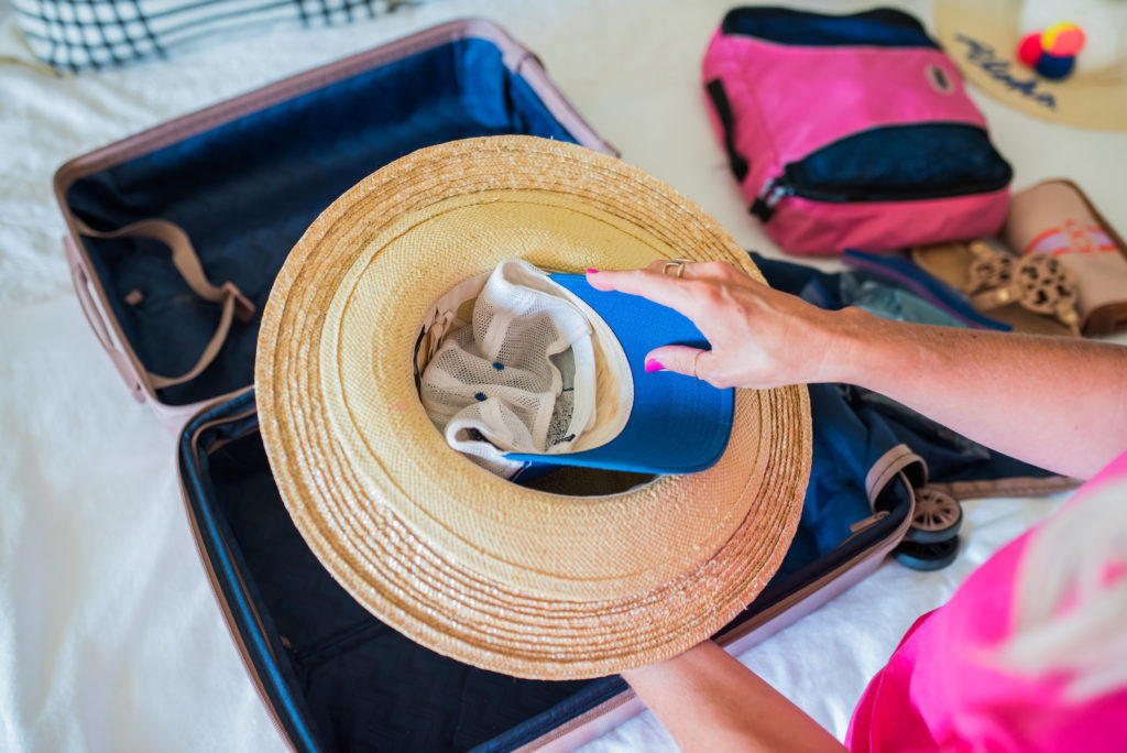 how to pack straw hats with a baseball hat in a carry on suitcase for flight travel