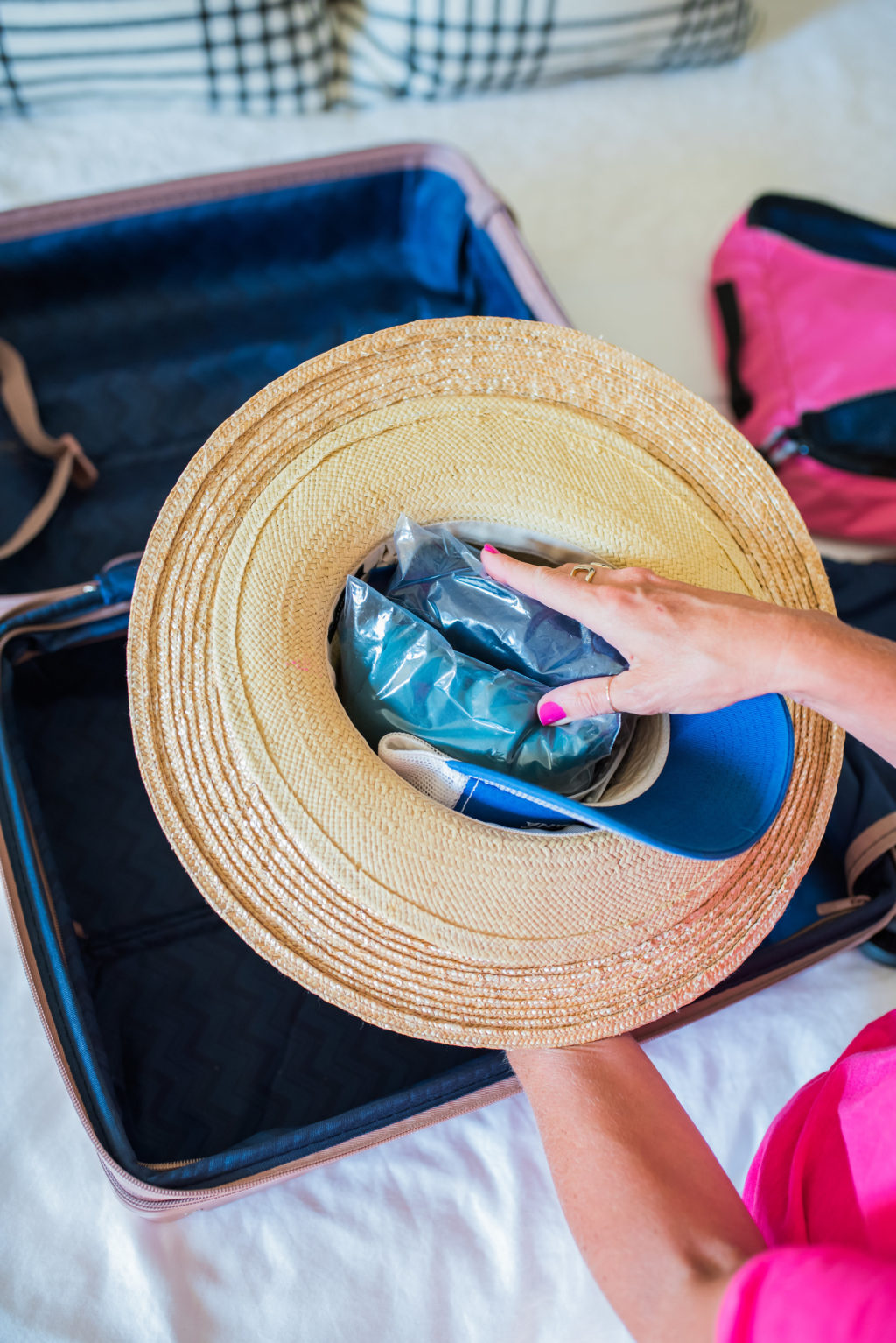 packing multiple hats in a carry on suitcase for travel
