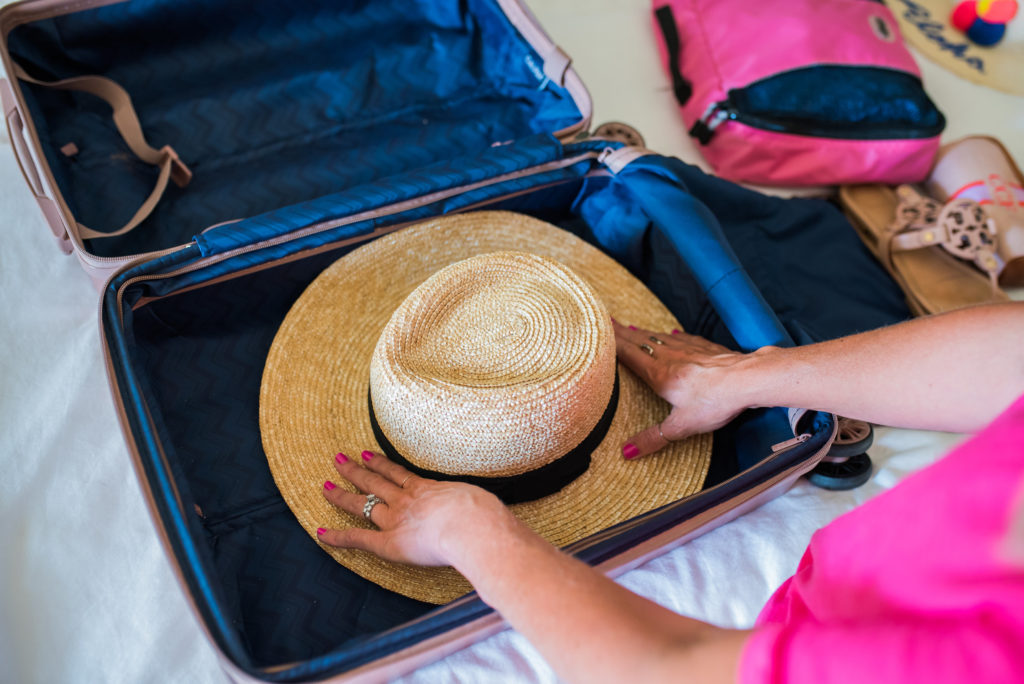 how to pack multiple hats without taking up room in a carry on suitcase